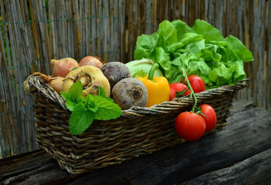 Brown basket of vegetables