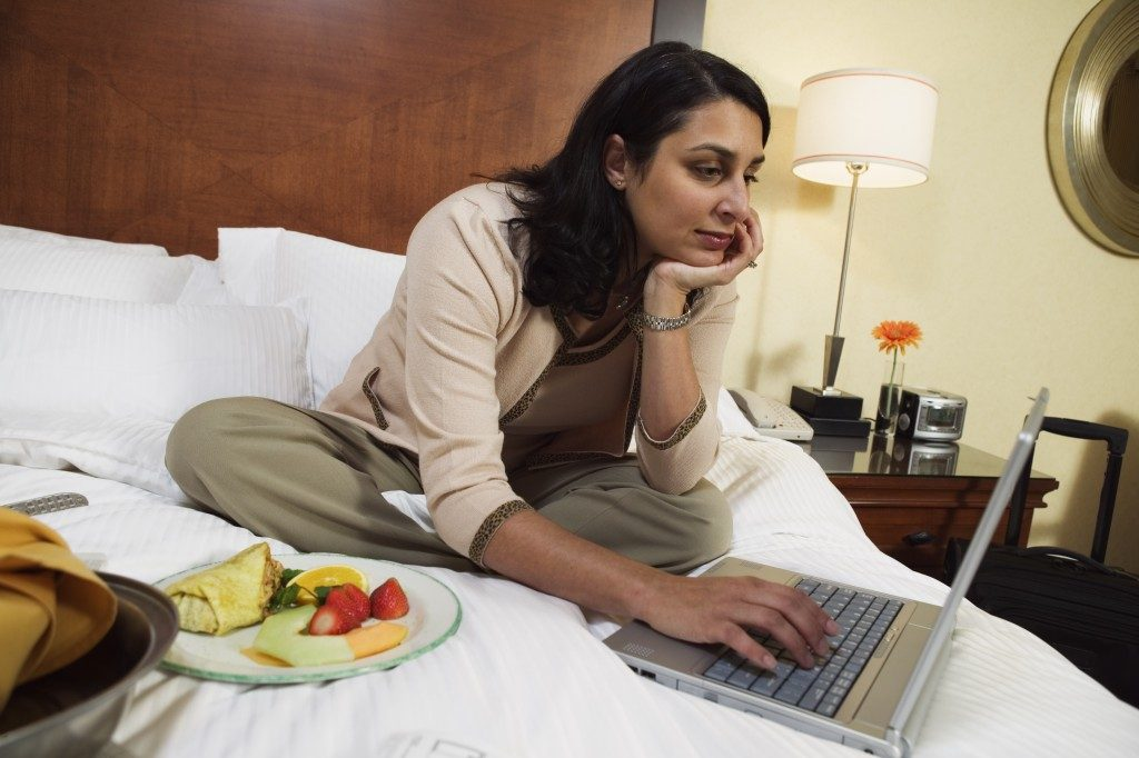 Woman in the hotel bed