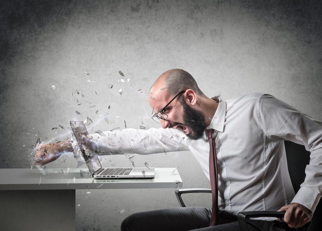 Man punching the laptop