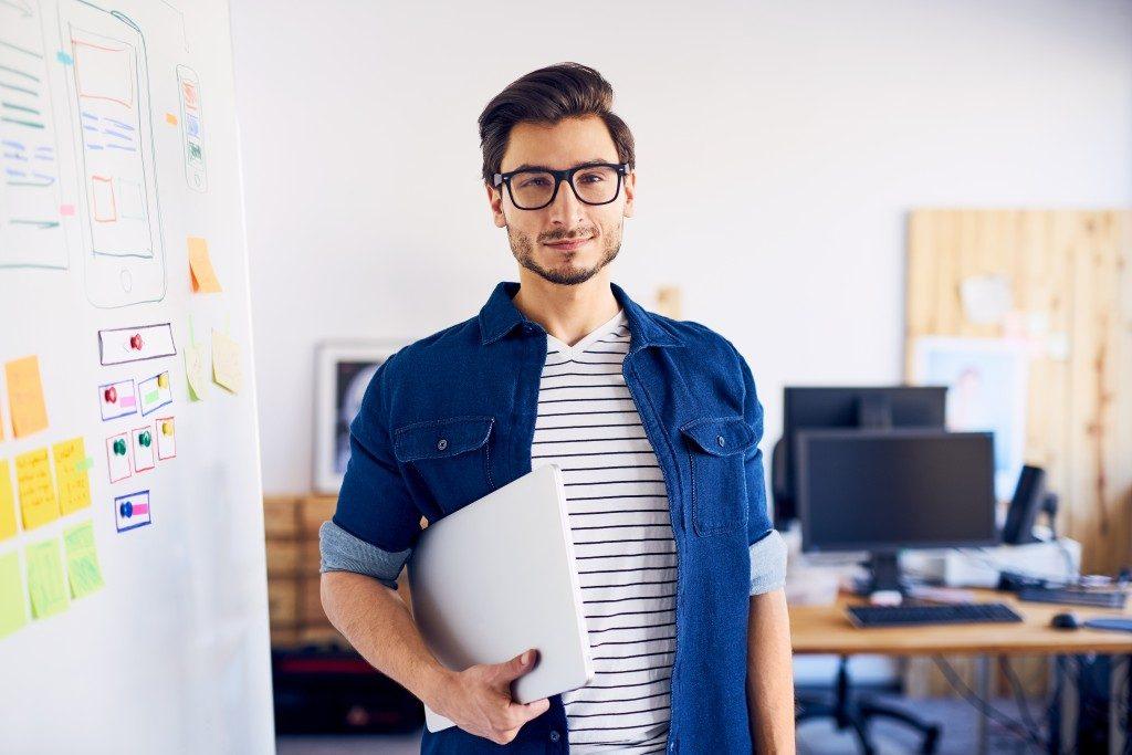 Interior designer with his laptop