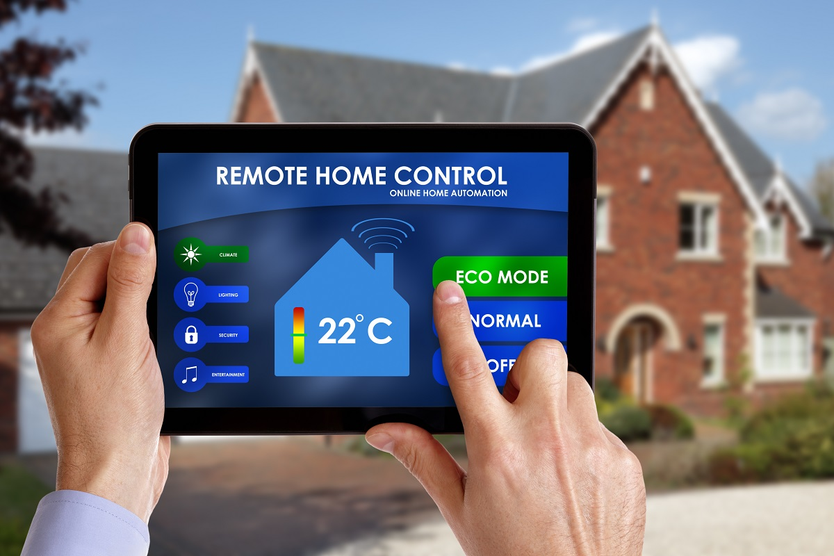 Man holding a remote home control