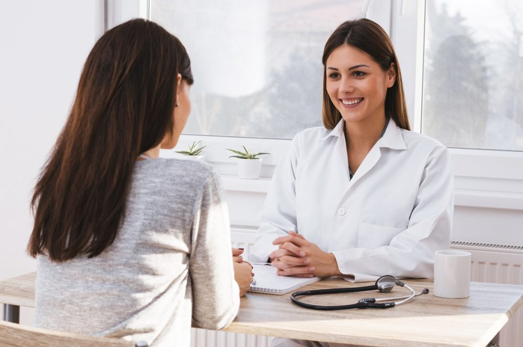 Female patient consulting a doctor