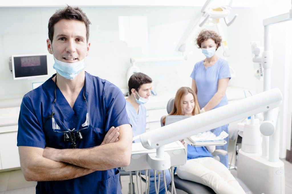 a team of dentists working