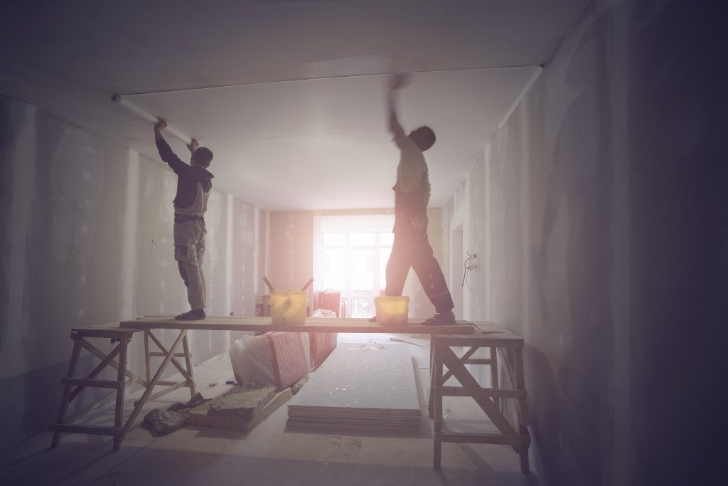 Workers remodeling an apartment