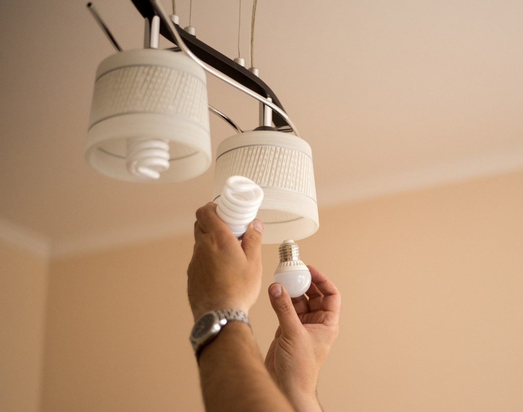 Person changing the light bulbs