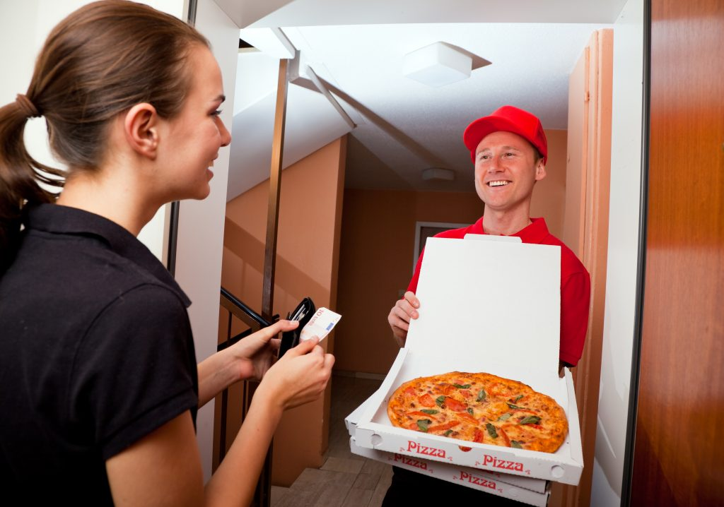 pizza delivery guy getting paid by woman