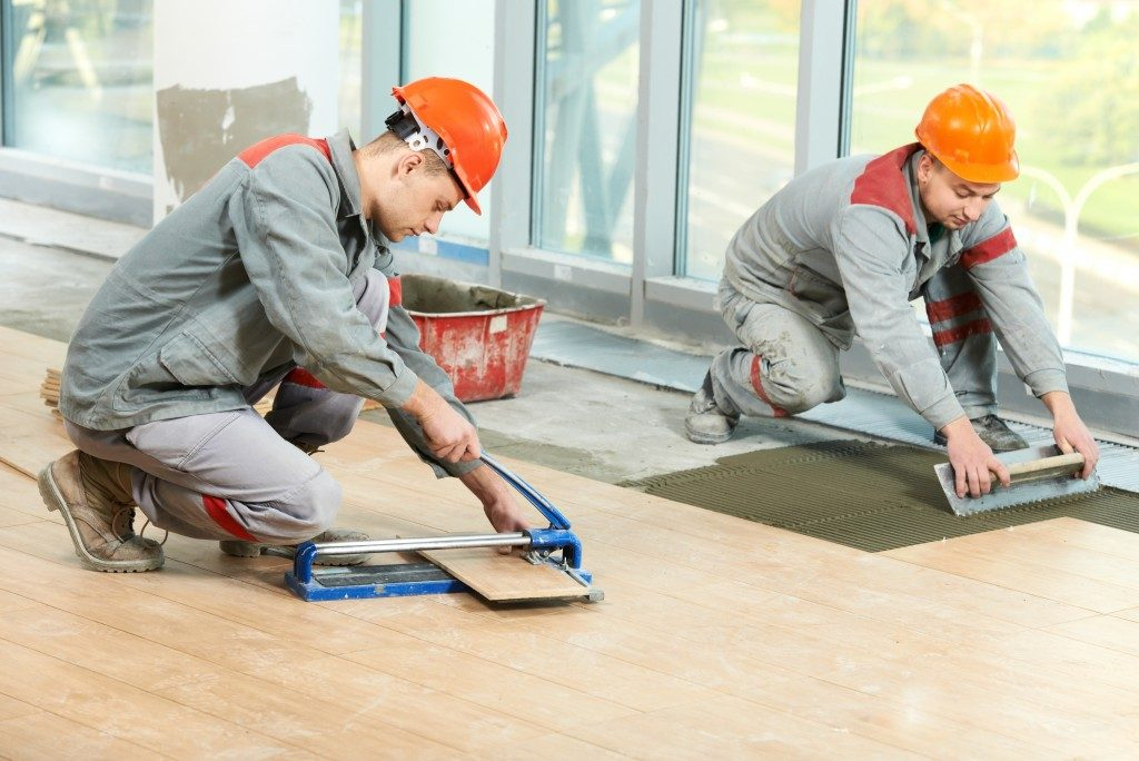men working on flooring