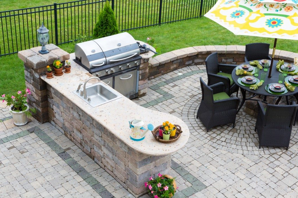 stylish outdoor kitchen and patio