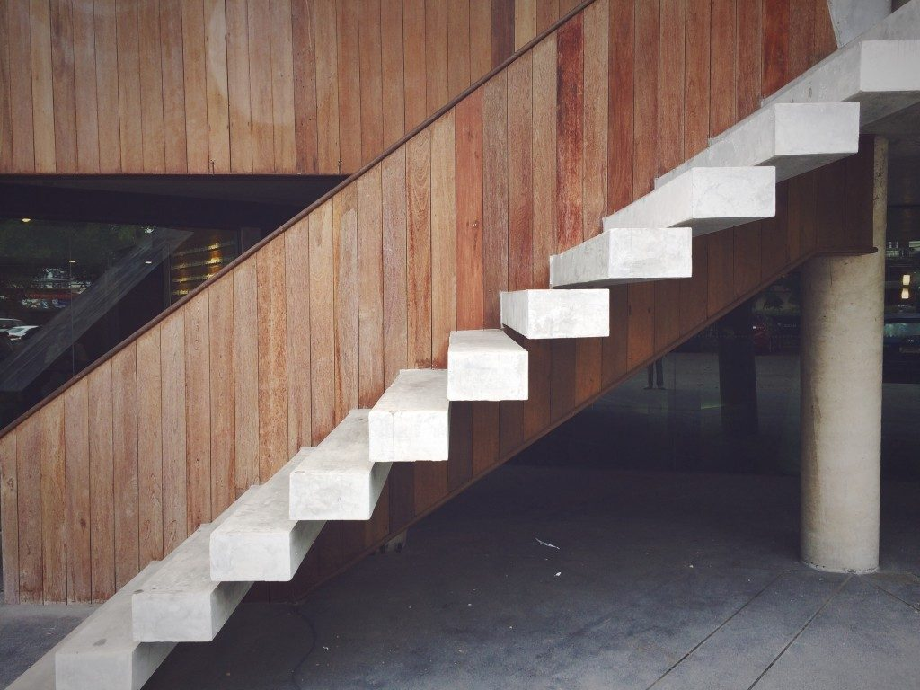 White floating staircase design with the wooden background