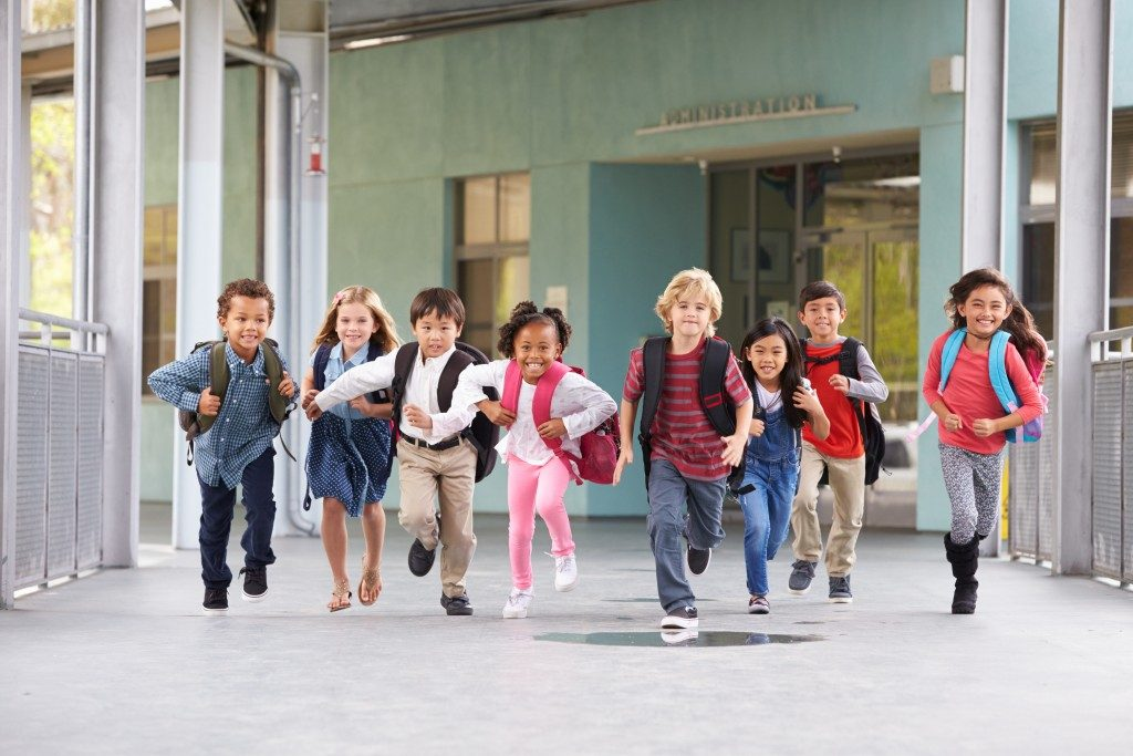 students running in school campus