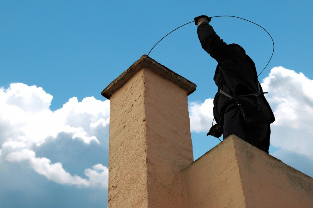 Chimney sweeper on the roof