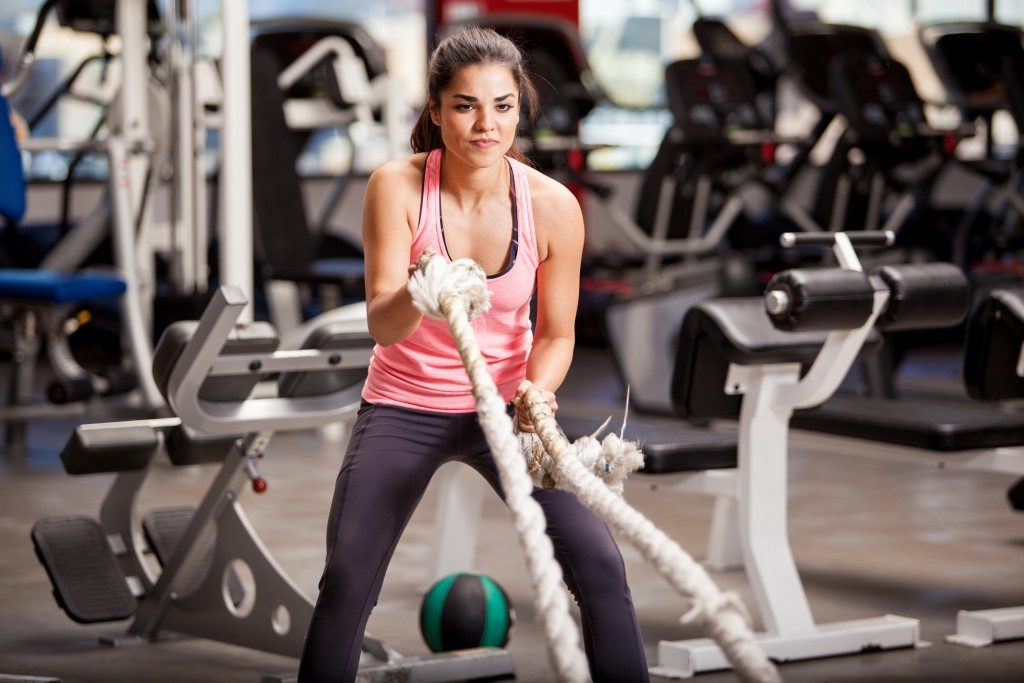 young woman doing some crossfit exercises
