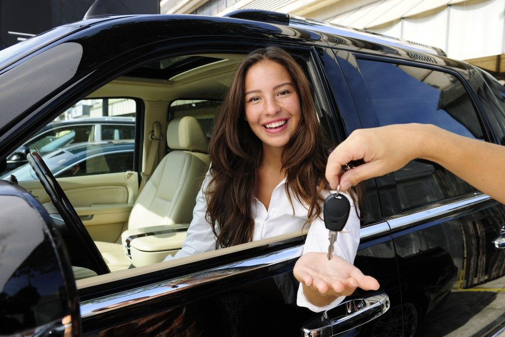 Girl getting the keys to her new car