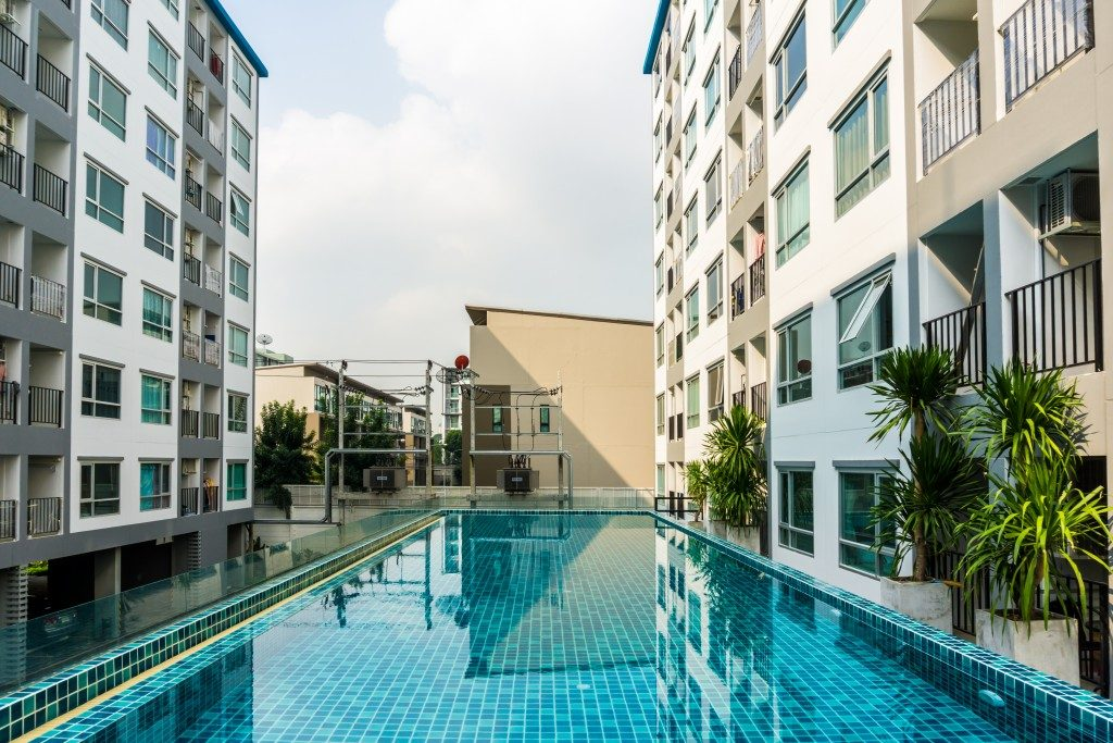 Swimming pool near townhouses