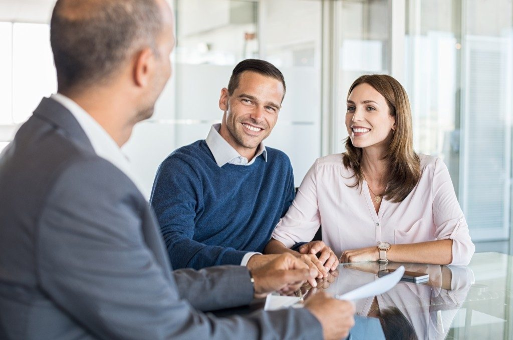 Agent discussing property with clients