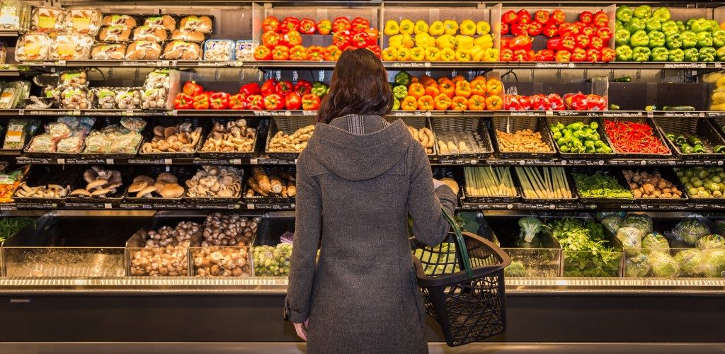 woman buying organic foods in the supermarket