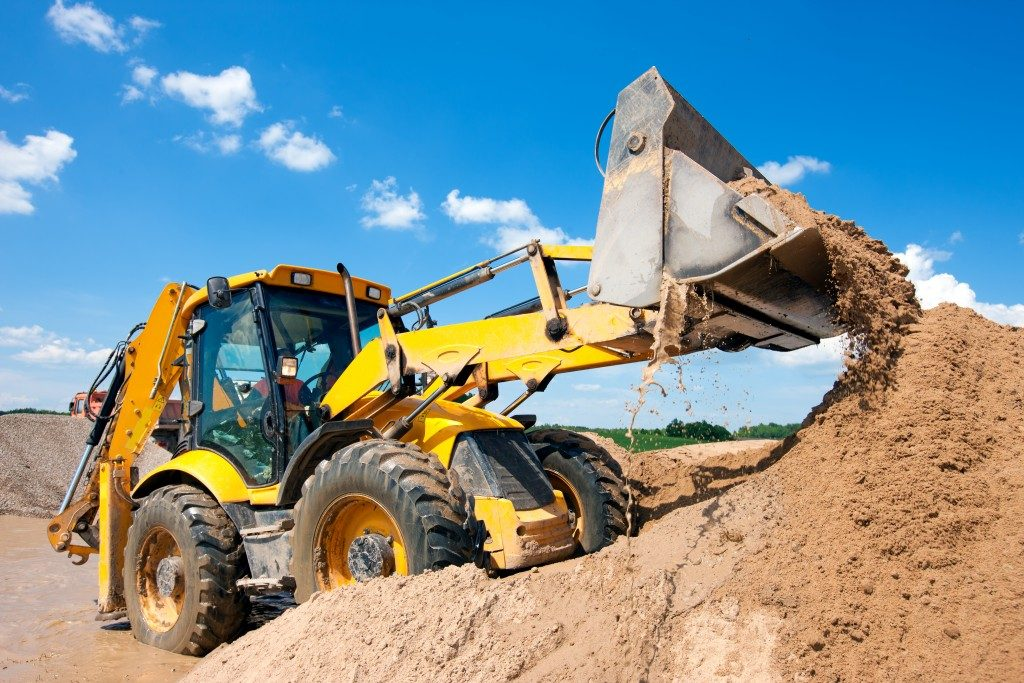 heavy equipment dropping sand