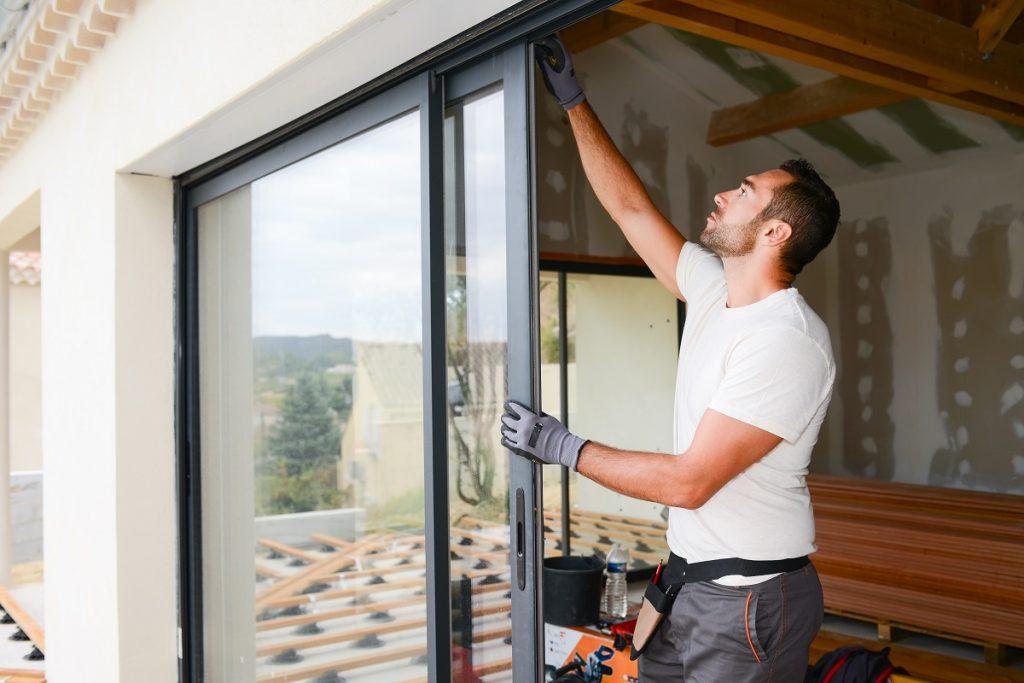 man installing glass windows