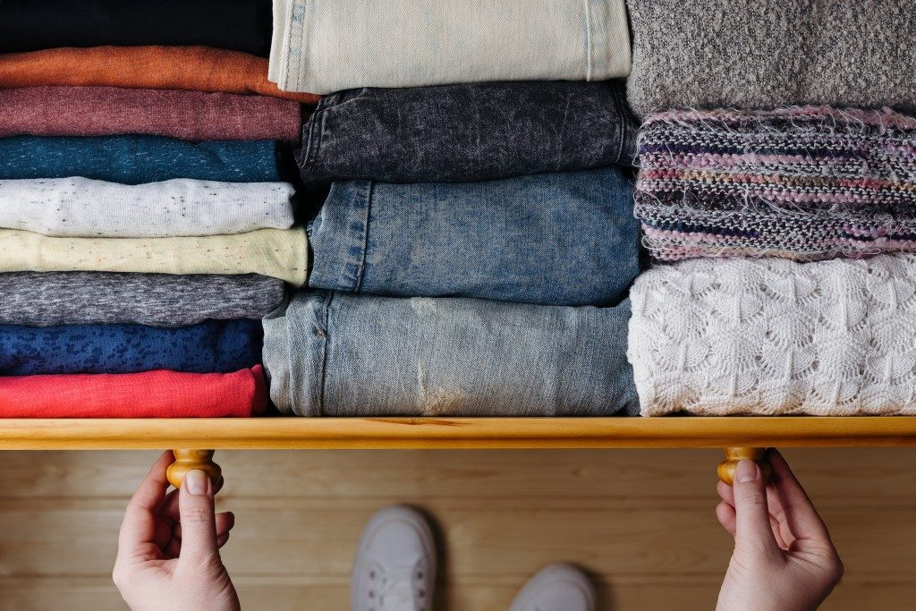 full drawer of folded clothes