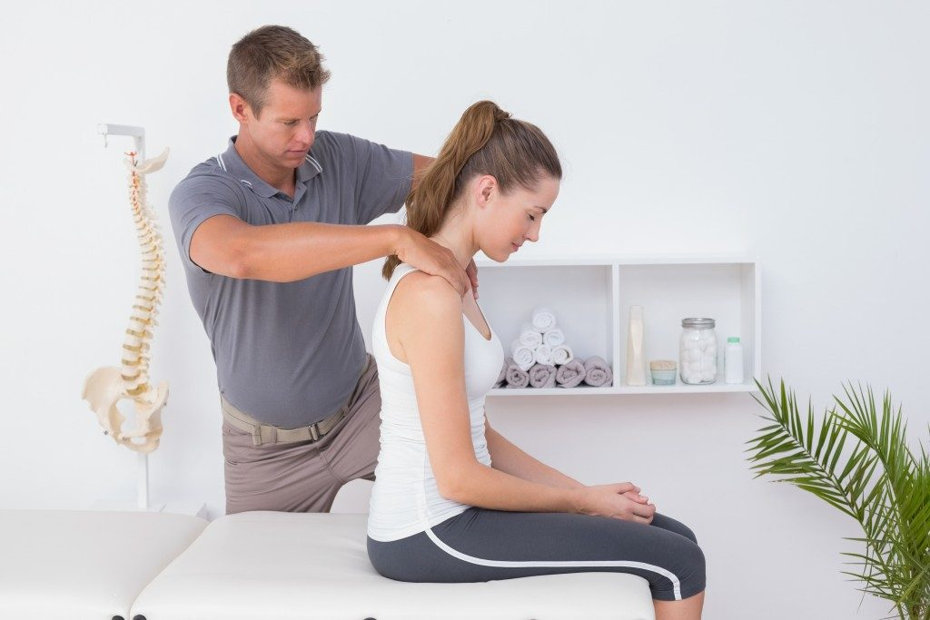 woman getting chiropractic therapy