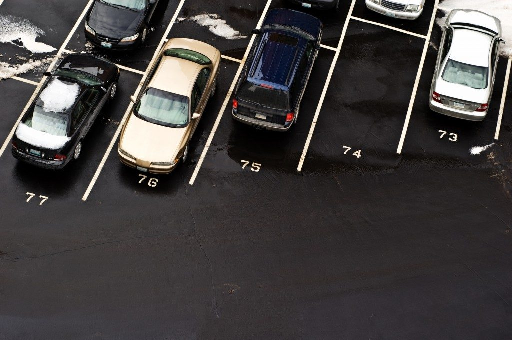 row of cars in a parking space