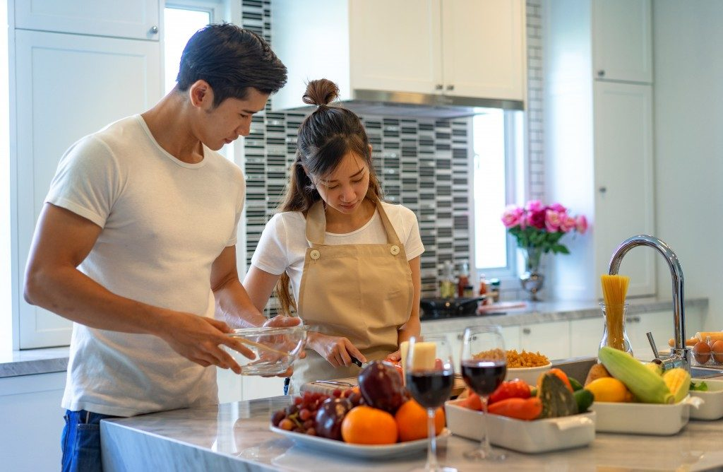 couple preparing food together