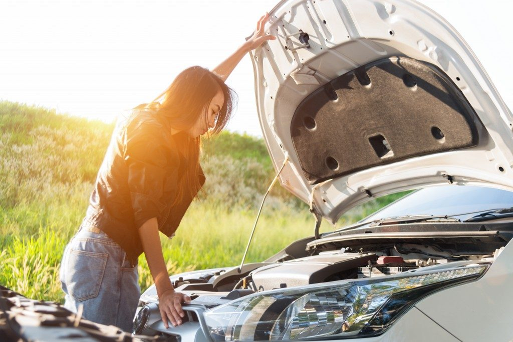 woman checking her car engine
