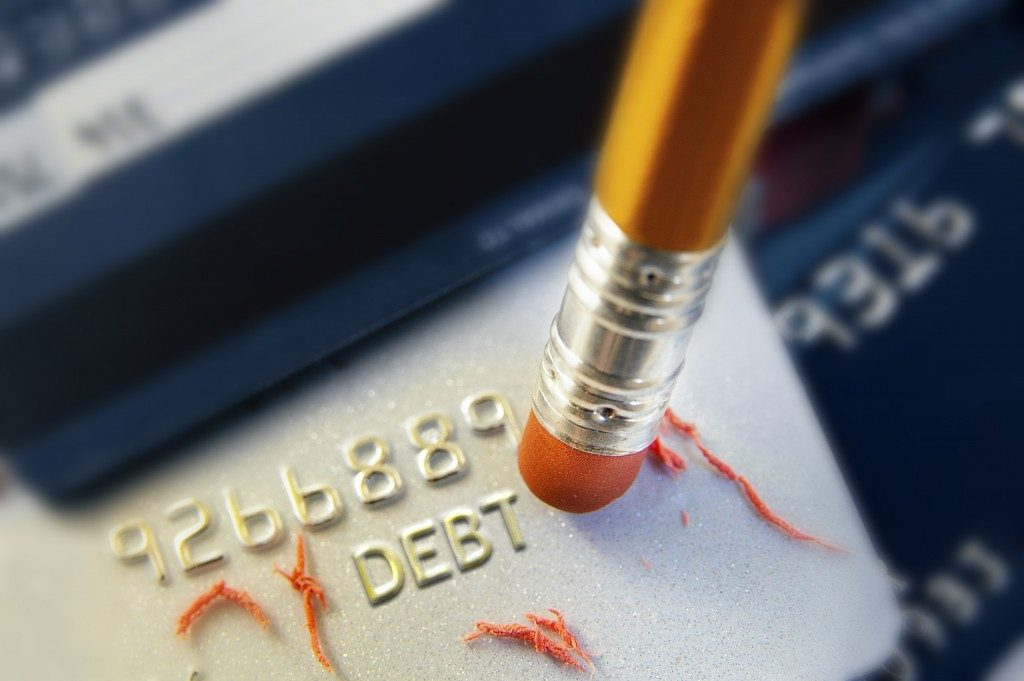 pencil erasing credit card debt
