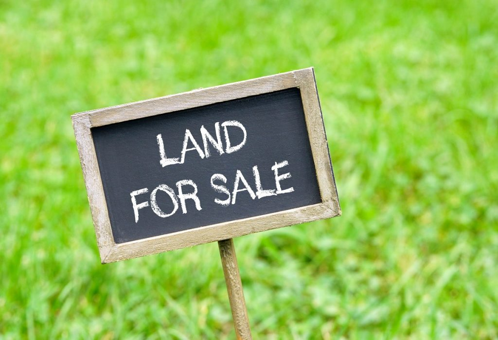 land for sale sign on grass