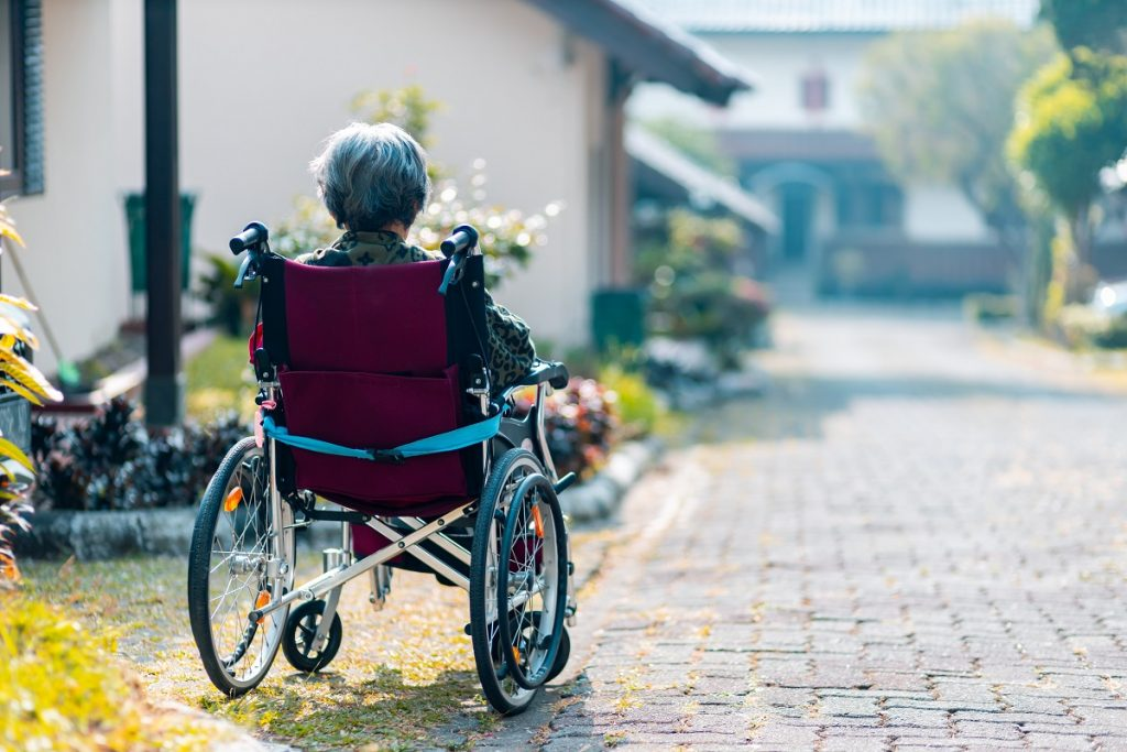 old woman on a wheelchair