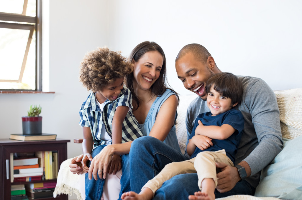 Multiethnic family sitting on sofa