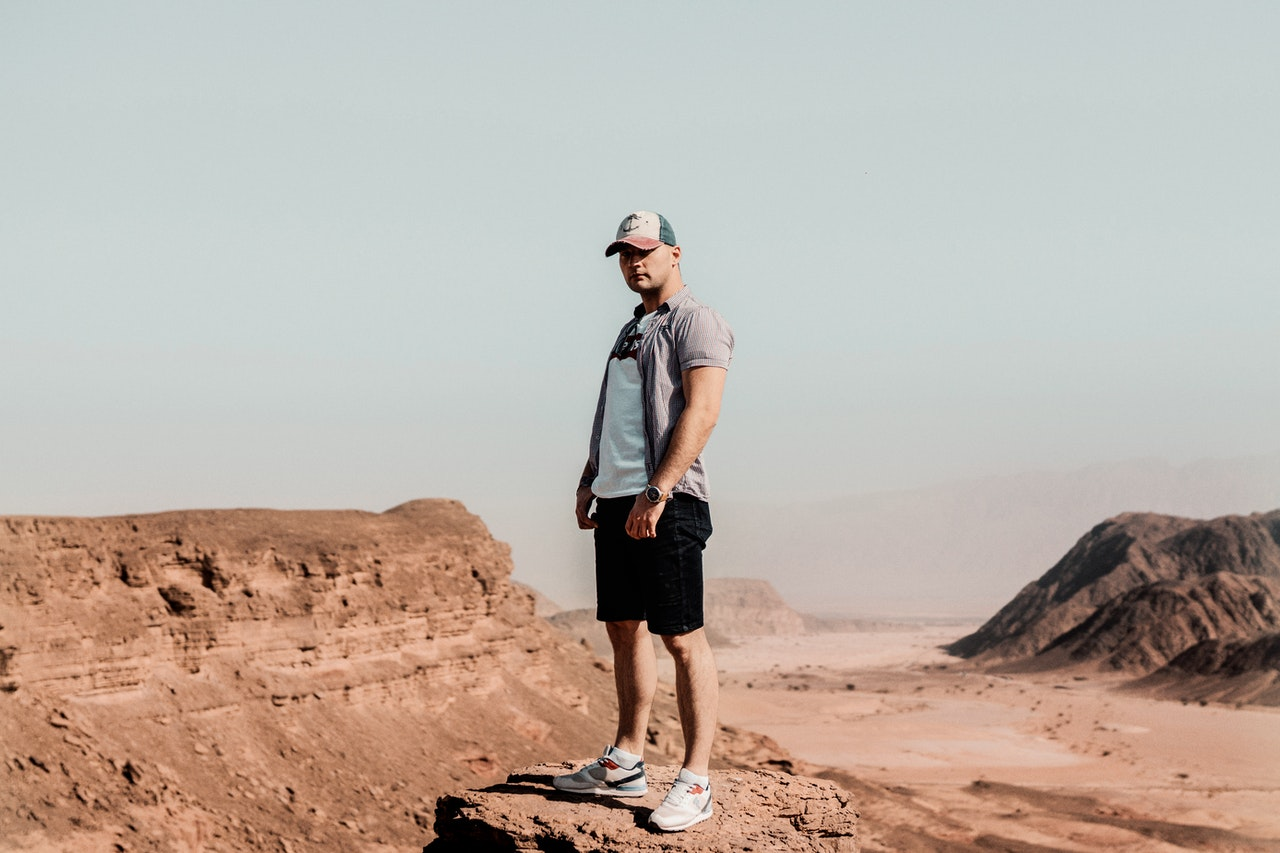 man standing in the middle of the desert
