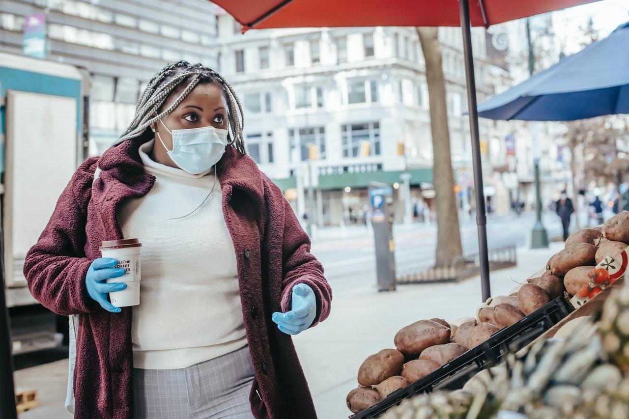 woman buying at a market