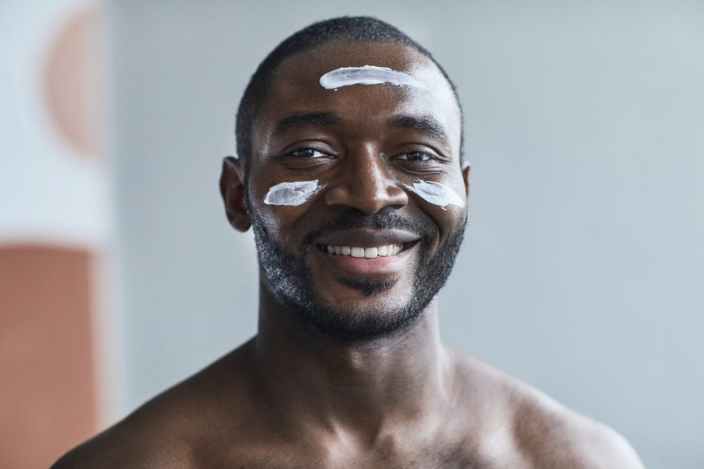 man using facial products