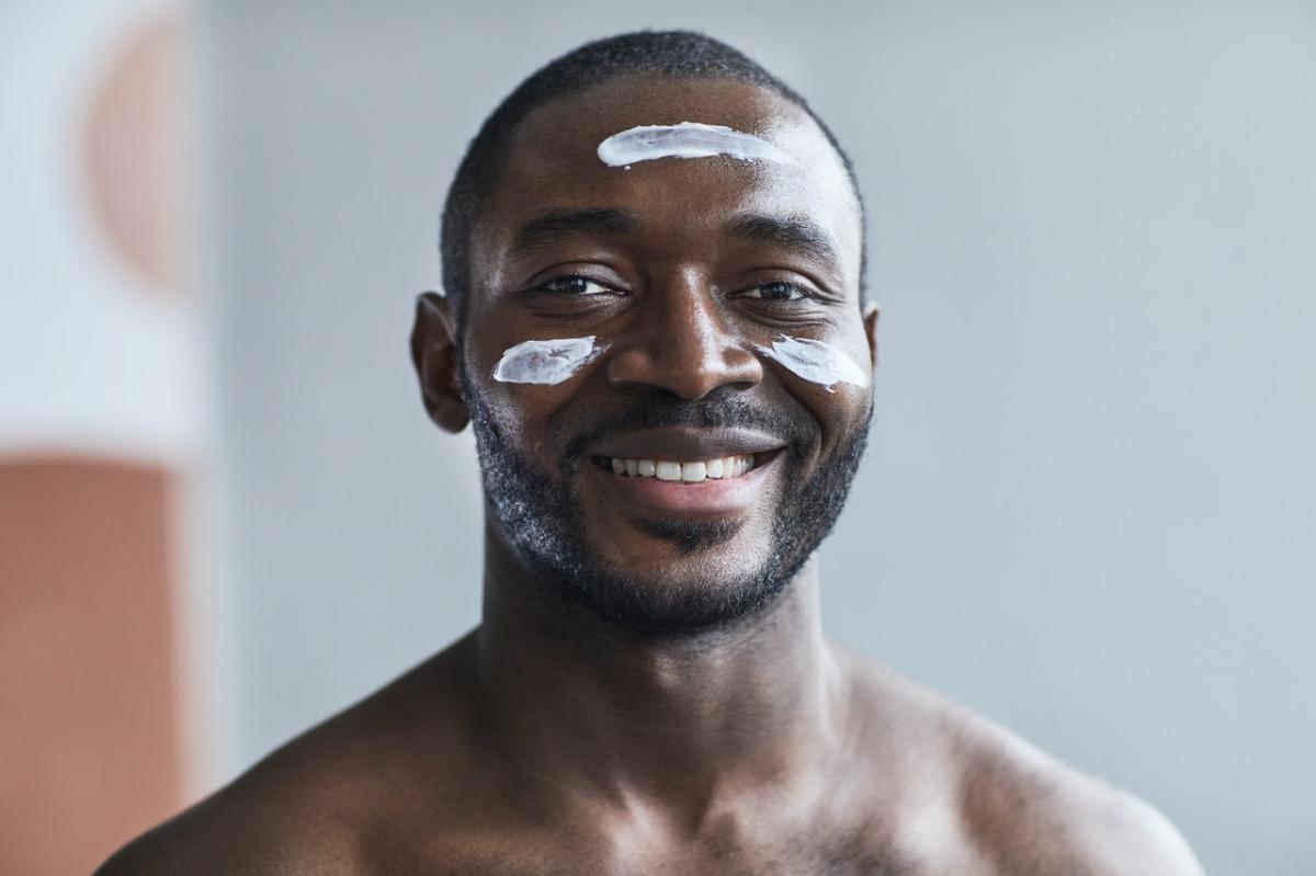 man using facial products