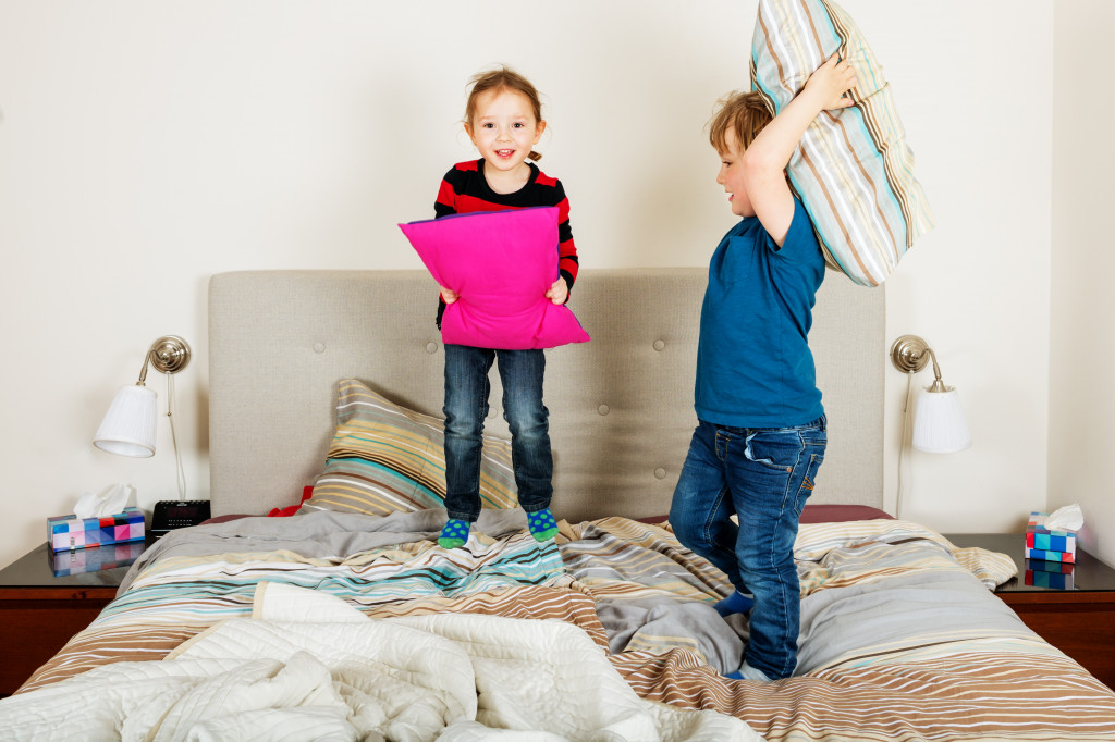 kids playing on the bed