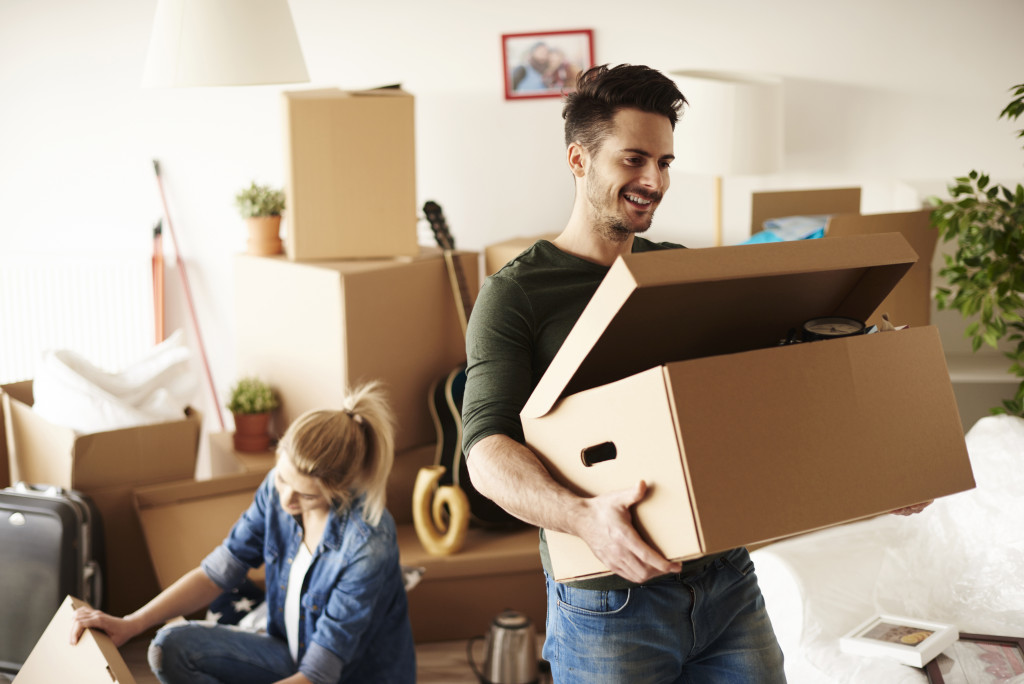 man and woman decluttering house equipment