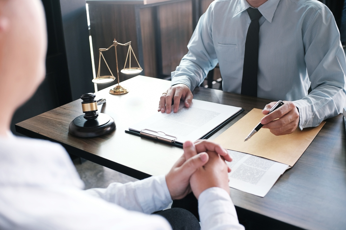 lawyer speaking to a client